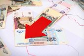 pic of paycheck  - Money and red arrow on graph document close up - JPG