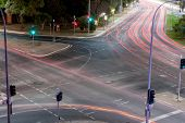 image of intersection  - Car light trails at traffic light intersection - JPG
