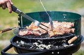 picture of grill  - grilling pork on live coals with grill tools - JPG