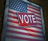 stock photo of democracy  - American vote concept and United States elections symbol as a window with a US flag with a voting sign as an icon for presidential or government political tradition of democracy to choose a candidate for a new term - JPG