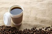 picture of sackcloth  - Paper cup of coffee with beans on sackcloth close up - JPG