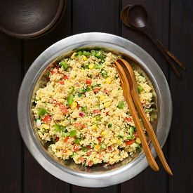 picture of sweet-corn  - Vegetarian couscous salad made with bell pepper tomato cucumber red onion and sweet corn kernels served in salad bowl with rustic bowls and wooden spoons on the side - JPG
