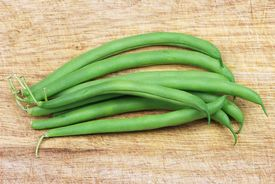 picture of green bean  - Whole green beans on a cutting board - JPG