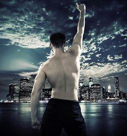 image of strongman  - Triumphant athletic strongman - JPG
