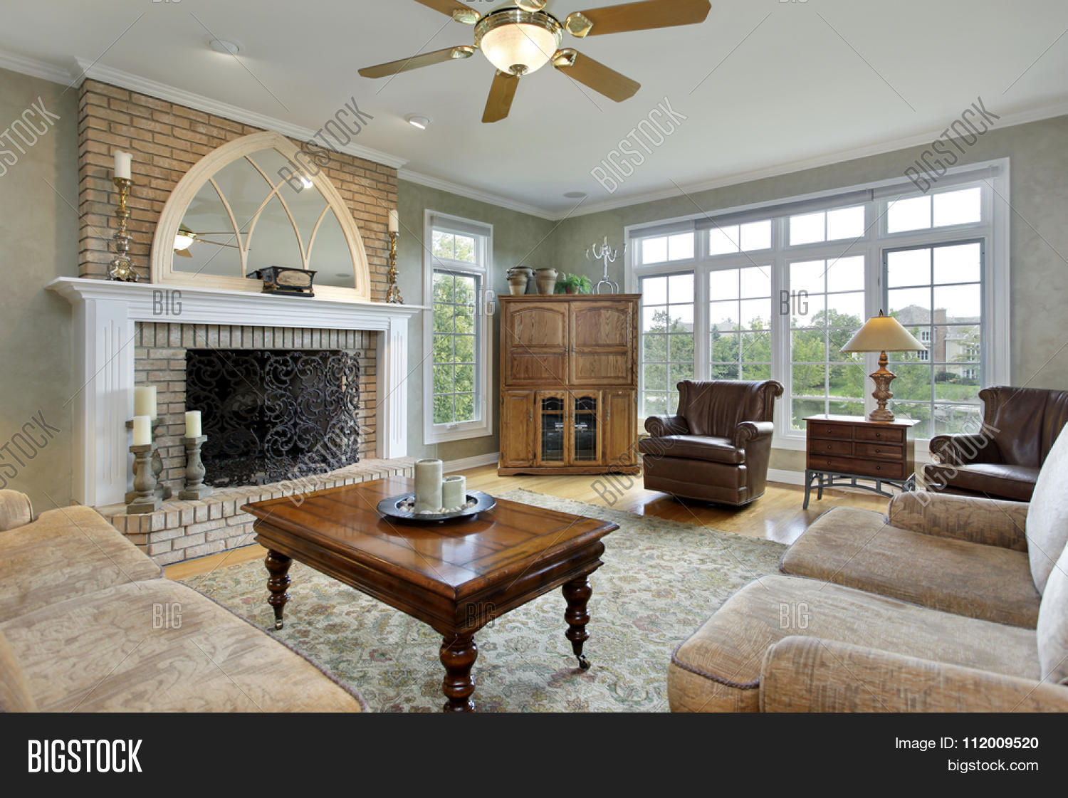 Family room in luxury home with large brick fireplace Luxury fireplaces luxury homes