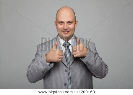 Bald businessman in a gray suit