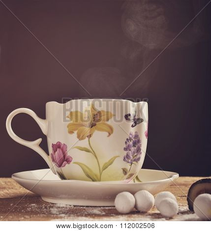 Cup Of Hot Tea On Wooden Background