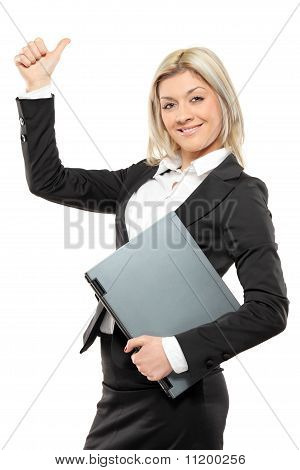Happy Businesswoman Holding A Laptop And Giving Thumbs Up