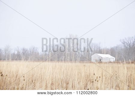 White wood barn on a cold winter's day