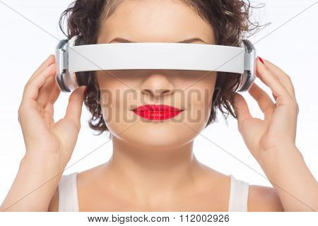 Attractive woman playing with headphones.