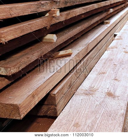Unplaned Thick Planks Covered With Antiseptic Preparation