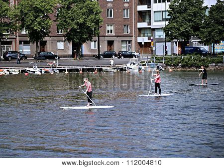 People Involved Stand Up Paddleboard