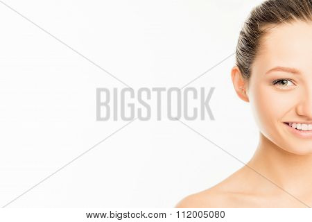 Half-face Portrait Of Cute Smiling Girl On White Background