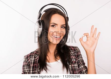 Portrait Of Young Smiling Girl With Head-phones Listening To Music