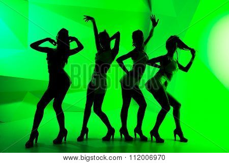 Black Silhouettes Of Dancing Girls On Green Background