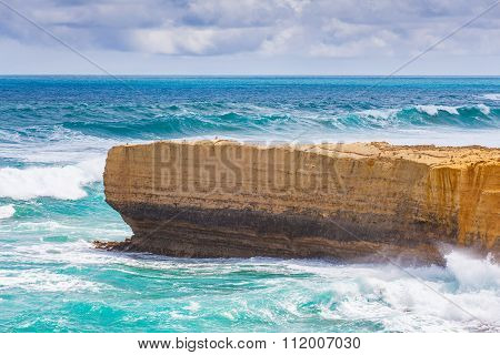 Limestone Rocky Outcrop Reaching Out Into Big Ocean Waves