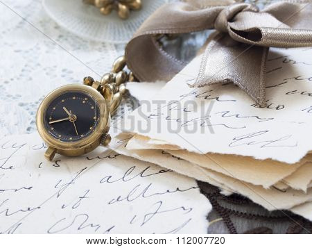 old letters with pen and watch