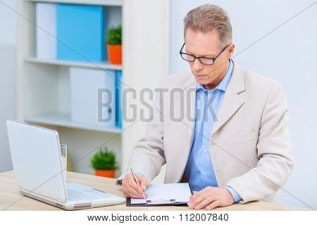 Businessman is busy doing paperwork.