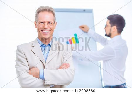 Two businessmen at conference room.