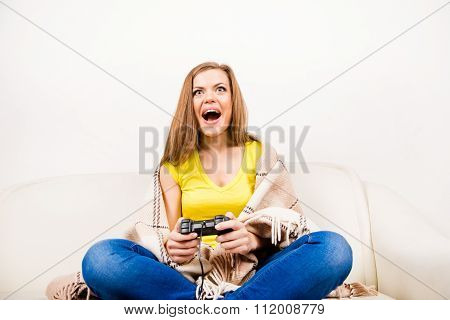Excited Girl Playing  With Game Console On Sofa