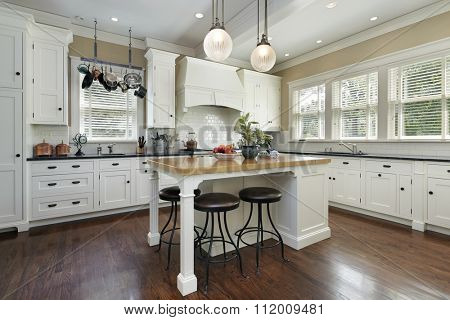 Kitchen with white cabinetry and center island