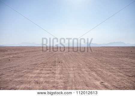 Landscape of Sahara desert with jeeps for safari