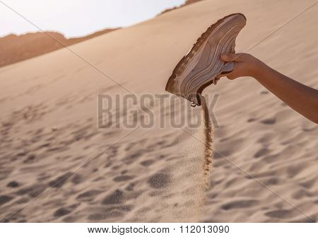 Upset a gym shoes full of sand