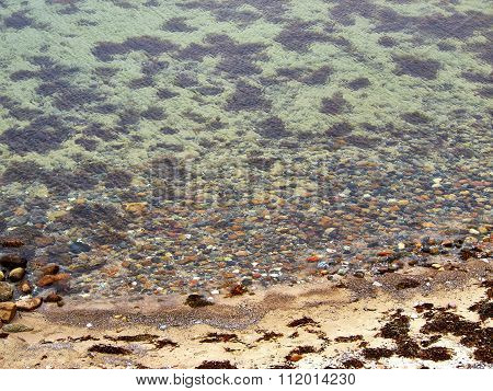 Top View Of Rocks In The Sea
