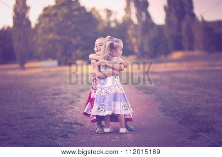 Two little sisters embracing - showing their love for each other ** Note: Soft Focus at 100%, best at smaller sizes