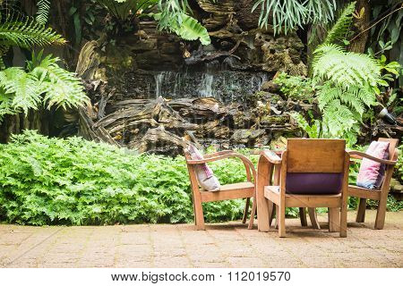 Outdoor Wooden Chair In The Garden