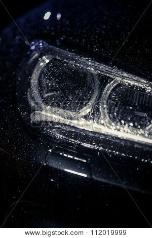 Car Headlight With Rain Drops