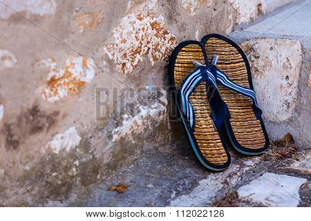 Beach Flip-flops On The Old Wall Background