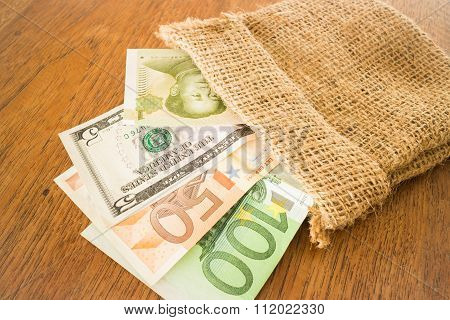 International Currencies Bank Note In The Sack
