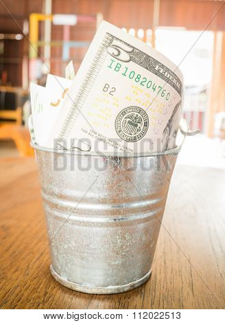 International Currencies Bank Note In The Bucket