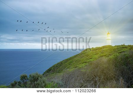 Lighthouse Shining Protective Light Over Ocean