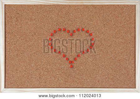 Heart Made Of Pushpins On Corkboard
