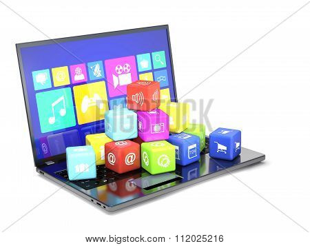 Laptop And Cubes With Icons On The Keyboard.