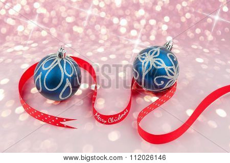 Christmas Baubles With Red Dotted Ribbon On Bokeh Background