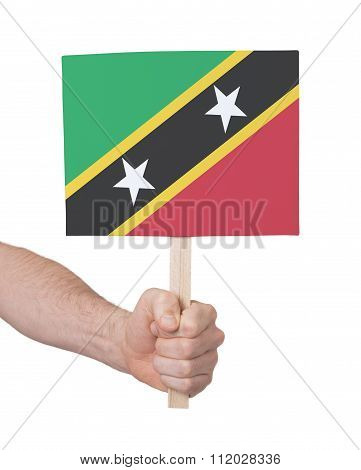 Hand Holding Small Card - Flag Of Saint Kitts And Nevis