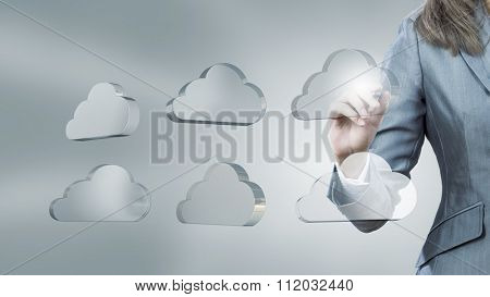 Businesswoman pushing with stylus glass cloud icon on screen