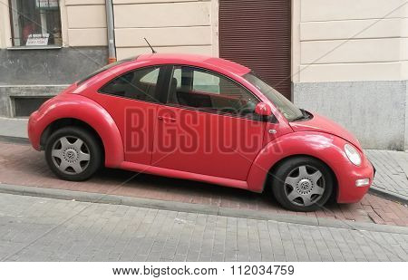 Red Volkswagen New Beetle