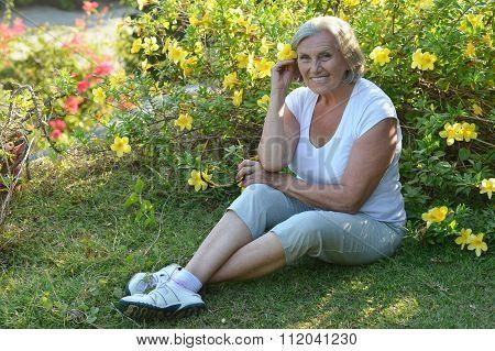 elderly woman   in tropical garden