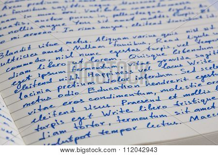 Extreme Closeup Of Open Notebook With Handwritten  Lorem Ipsum Text