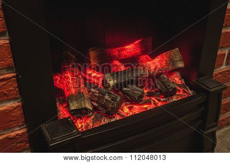 the real fireplace with the burning firewood