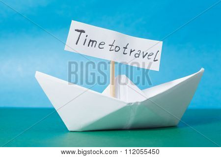 Paper Boat With A Sign Time To Travel - Travel Concept