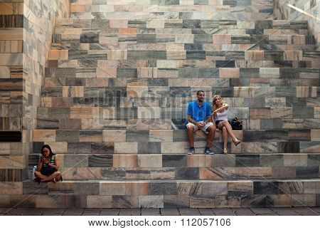 Couple Sitting On Staircase
