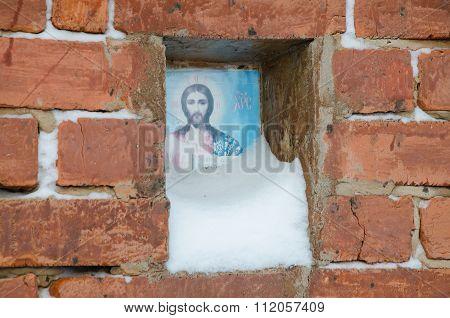 Snow-covered Icon Of Jesus Christ