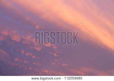 a pink and blue sky full of colors in a sunset
