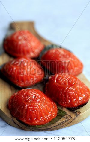Ang ku kueh or chinese red tortoise cake is a traditional asian kueh dessert puddding made from glutinous rice flour with a salty or sweet filling
