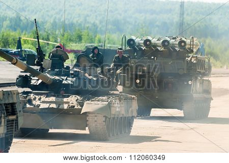 Convoy of T80U tank and Buk-M1-2 in motion. Russia